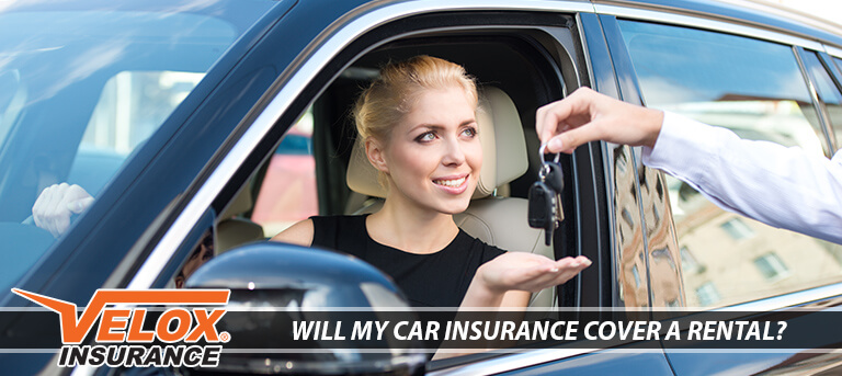 Blonde woman renting a car