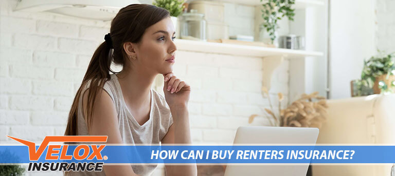 Woman wondering about renters insurance in front of a laptiop