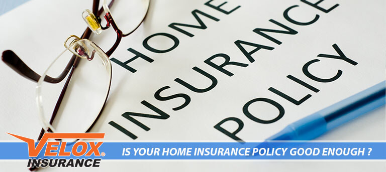 Home Insurance policy with eye glasses on top