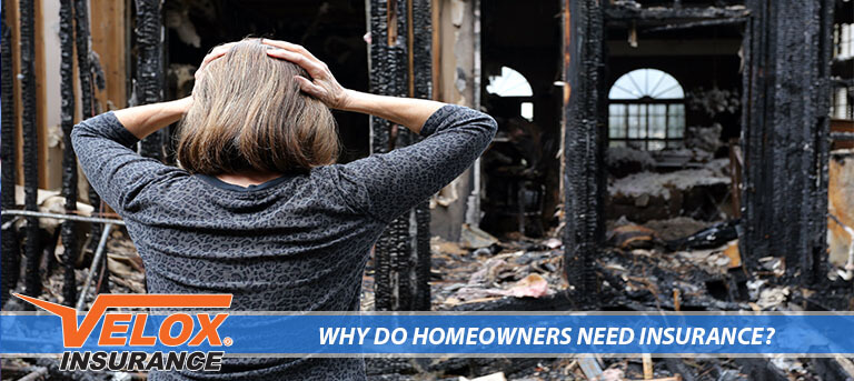 Woman looking at a burned down home